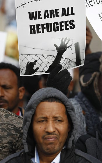African migrants demonstrate against Israel's policy to forcibly deport African refugees and asylum seekers, outside the Rwanda embassy on January 22, 2018 in the Israeli city of Herzliya.