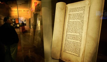 File photo: A portion of a Torah scroll is displayed at the Maltz Museum of Jewish Heritage in Ohio.