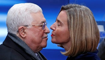 European High Representative for Foreign Affairs Federica Mogherini welcomes Palestinian President Mahmoud Abbas in Brussels, Belgium, January 22, 2018. REUTERS/Yves Herman