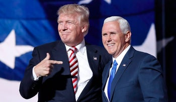 Then-presidential candidate Donald Trump points toward then-Gov. Mike Pence of Indiana after Pence's acceptance speech during the third day session of the Republican National Convention in Cleveland. July 20, 2016
