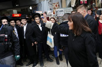 Karen Pence, the wife of US Vice President, waves to people after shopping at a jewellery shop in the Christian quarter of Jerusalem's Old City. January 23, 2018