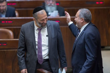 Arye Dery and Avigdor Lieberman at the Knesset.