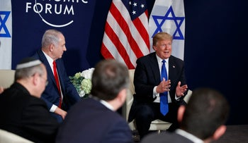 Prime Minister Benjamin Netanyahu looks on as President Donald Trump speaks during a meeting at the World Economic Forum, Thursday, Jan. 25, 2018, in Davos. (AP Photo/Evan Vucci)