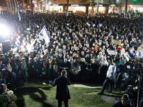 Thousands of Ashdod residents protest a law threatening to shutter shops on Shabbat on Saturday, January 20, 2018.