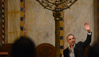 Former-U.S. President Barack Obama greets the audience at Temple Emmanuel in Manhattan, New York, January 25, 2017.