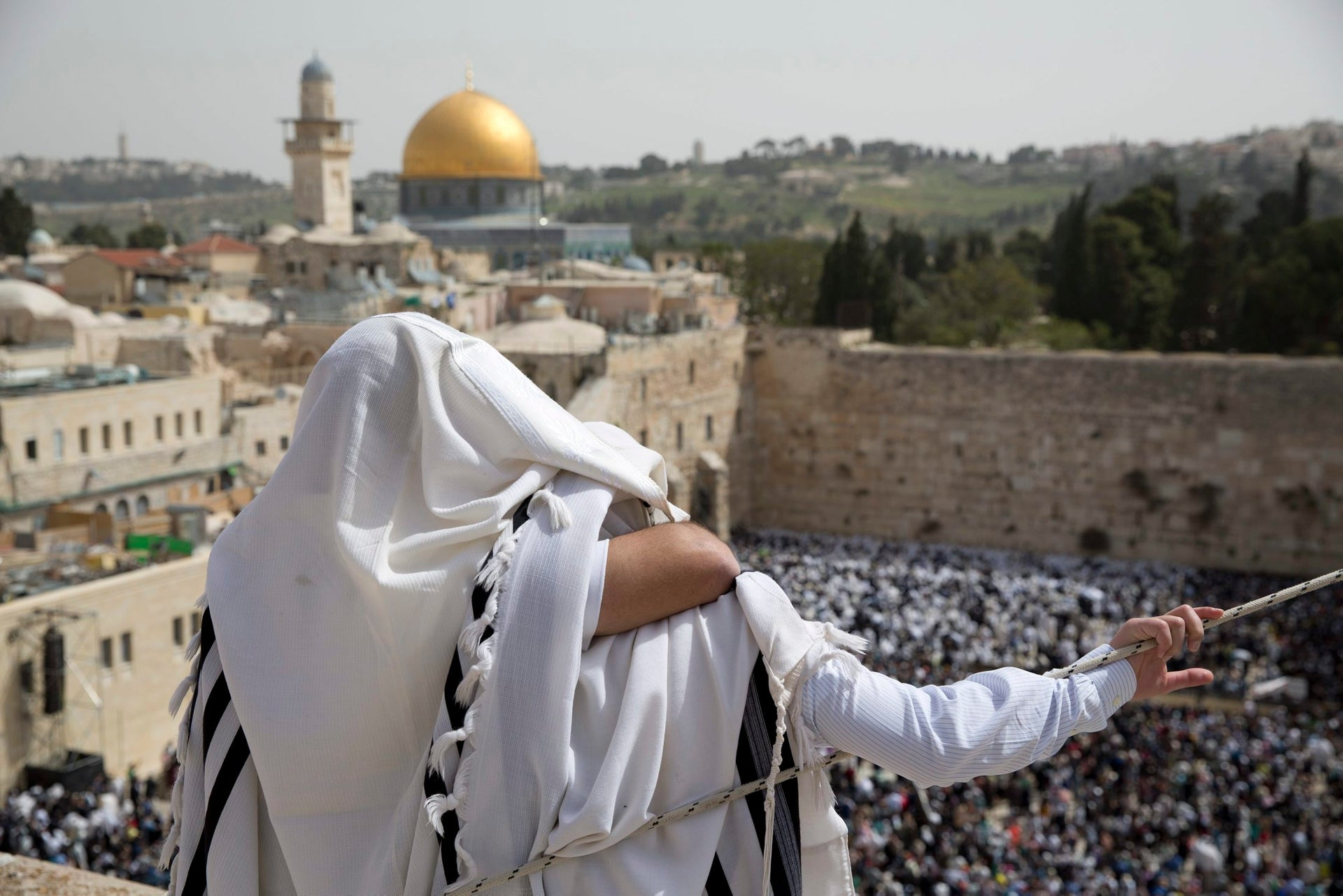 Jewish men of the kohanim priestly caste participate in a blessing during the Passover holiday, in front of the Western Wall  in Jerusalem's Old City, April 13, 2017.