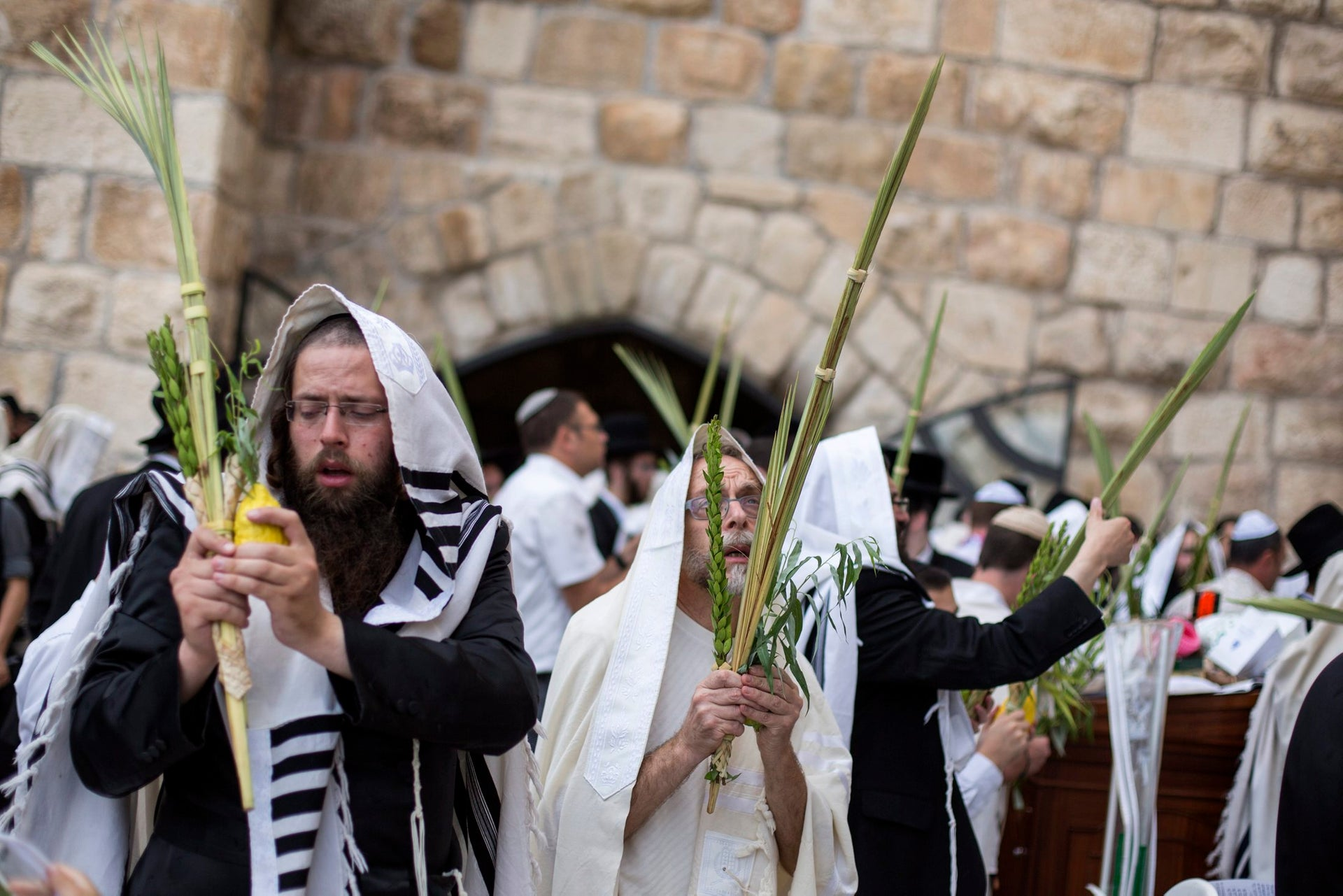 Worshippers recite the priestly blessing at the Western Wall in Jerusalem's Old City during the Jewish holiday of Sukkot, 2015.