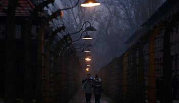 Survivors and guests walk inside the barbed wire fences at the former Nazi German concentration and extermination camp Auschwitz, during the ceremonies marking the 73rd anniversary of the liberation of the camp and International Holocaust Victims Remembrance Day, in Oswiecim, Poland, January 27, 2018. REUTERS/Kacper Pempel