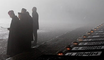 A thick evening fog clouds the former Nazi German concentration and extermination camp Auschwitz II-Birkenau during ceremonies marking the 73rd anniversary of the camp's liberation, January 27, 2018.