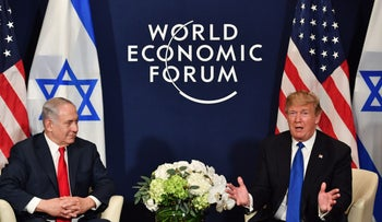 U.S. President Donald Trump speaks with Prime Minister Benjamin Netanyahu during a meeting at the World Economic Forum meeting in Davos, Switzerland on January 25, 2018.
