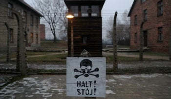 """A sign reading """"Stop!"""" in German and Polish at the site of the Auschwitz concentration camp in Oswiecim, Poland, January 27, 2018."""