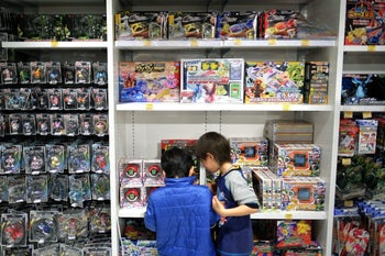 File photo: Boys look at Toys.