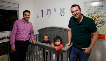 Elad Dvash-Banks, left, and his partner, Andrew, pose for photos with their twin sons, Ethan, center right, and Aiden in their apartment Tuesday, Jan. 23, 2018, in Los Angeles.