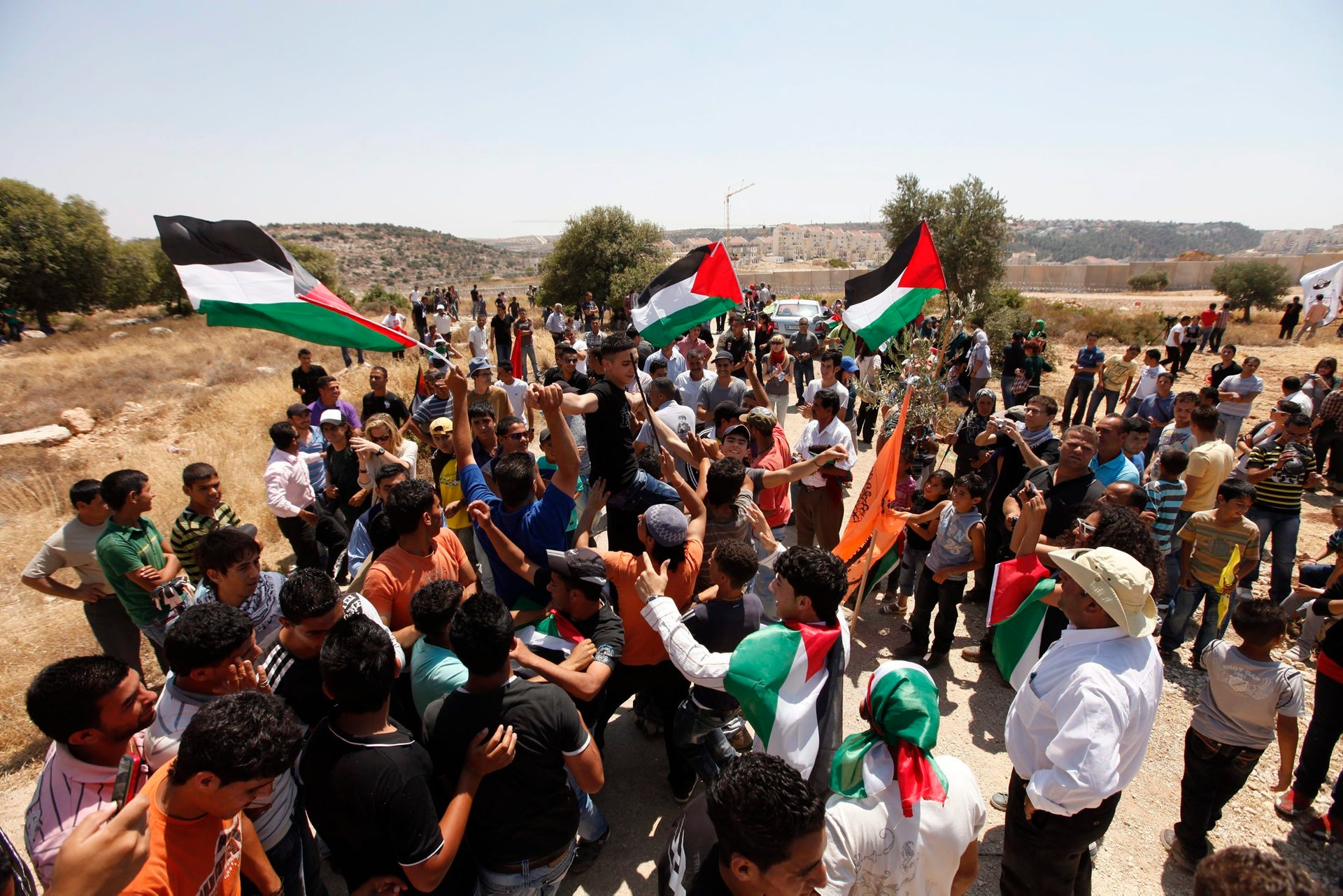 Palestinians celebrate the rerouting of the separation barrier between Bi'lin and the settlement of Modi'in Ilit, September 26, 2011.
