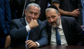 Interior Minister Arye Dery, right, with Prime Minister Benjamin Netanyahu in the Knesset, October 2017.