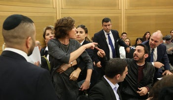 Knesset Member Tamar Zandberg being escorted out by security from hearing on African asylum seekers