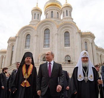 Russian President Vladimir Putin with Russian Orthodox Patriarch Kirill (R) and Bishop Tikhon Shevkunov (L) in Moscow, Russia. Father Tikhon believes the last Tsar was a victim of 'ritual murder'. May 25, 2017