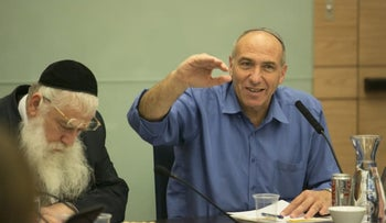 MK Moti Yogev, right, speaking at a meeting of the Knesset Foreign Affairs and Defense Committee in 2014.