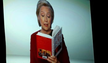 """Hillary Clinton appears on screen reading an excerpt from the book """"Fire and Fury"""" during a skit at the 60th annual Grammy Awards at Madison Square Garden on Sunday, Jan. 28, 2018, in New York."""