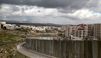 The security barrier running between the East Jerusalem refugee camp of Shuafat (R) and Pisgat Ze'ev, both located in an area Israel annexed to Jerusalem in 1967, February 15, 2017.