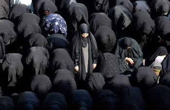Praying Iranian women in traditional headscarves. December 23, 2013.