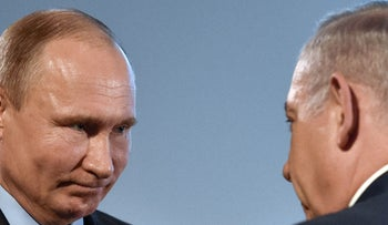 Russian President Vladimir Putin and Prime Minister Benjamin Netanyahu attend an event in Moscow, Russia, January 29, 2018.