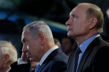 Israeli Prime Minister Benjamin Netanyahu and Russian President Vladimir Putin, right, attend a meeting marking 75th anniversary of the Sobibor uprising, the only successful uprising that took place in a death camp during World War II at the Jewish Museum and Tolerance Center in Moscow in Moscow, Russia, Monday, Jan. 29, 2018. (Maxim Shemetov/Pool Photo via AP)