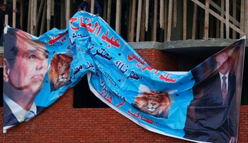 A poster cheering for Sissi's re-election hangs on the street in Cairo, Egypt.