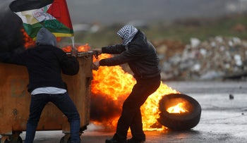 Palestinians clash with Israeli troops following a protest against a U.S. President Mike Pence protest visit to Israel, in the West Bank city of Ramallah, Tuesday, Jan. 23, 2018. (AP Photo/Majdi Mohammed)