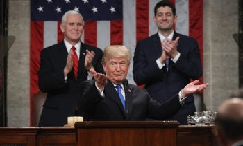 U.S. President Donald Trump, center, gestures while delivering a State of the Union address to a joint session of Congress at the U.S. Capitol in Washington, D.C., U.S., on Tuesday, Jan. 30, 2018.