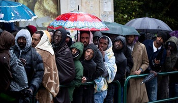 African asylum seekers wait outside of the Interior Ministry on Salameh Street in south Tel Aviv, January 23, 2018.
