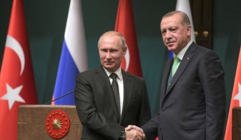 Turkey's President Recep Tayyip Erdogan, right, shakes hands with Russia's President Vladimir Putin, left, following their joint news statement after their meeting at the Presidential Palace in Ankara, Monday, Dec. 11, 2017