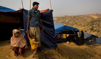 Rohingya Muslim refugee Mohammad Younus, 25, from the Myanmar village of Gu Dar Pyin, stands on a hill of Kutupalong refugee camp, Bangladesh on January 14, 2018.