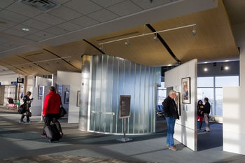 """People viewing the """"Transfer of Memory"""" exhibition at Minneapolis-Saint Paul International Airport. Tens of thousands of football fans will be passing through the airport ahead of Super Bowl LII on February 3, 2018."""