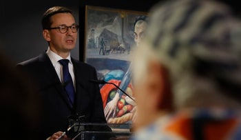 Polish Prime Minister Mateusz Morawiecki speaks at a commemoration event at Auschwitz II-Birkenau, during the ceremonies marking International Holocaust Victims Remembrance Day, near Oswiecim, Poland, January 27, 2018.