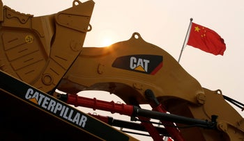 A Caterpillar excavator is displayed at the China Coal and Mining Expo 2013 in Beijing, China October 22, 2013.