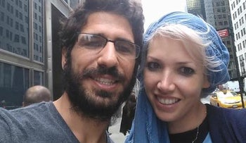 Shimon Abta and his wife in an image taken from his Facebook page