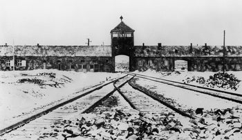 This file photo taken in January 1945 shows Auschwitz concentration camp gate and railways after its liberation.