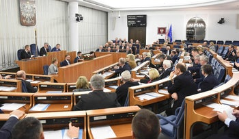 Polish senators attending an overnight session in Warsaw on February 1, 2018, where the upper house voted 57-23 to approve the bill that sets fines or a maximum three-year jail term for anyone referring to Nazi German death camps as Polish.