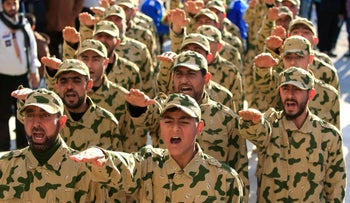 Hezbollah fighters parade during a ceremony in Tefahta village, south Lebanon, February 18, 2017.