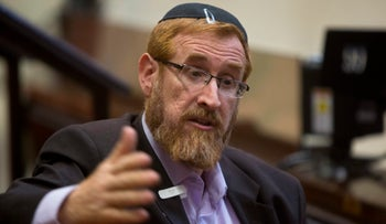 MK Yehuda Glick speaks during an interview with The Associated Press at the Knesset in Jerusalem, June 2, 2016.