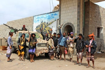 Fighters from the separatist Southern Transitional Council standing at the entrance of a military camp after they took control of the pro-government position in the Dar Saad district, in the north of Aden, Yemen, on January 31, 2018.
