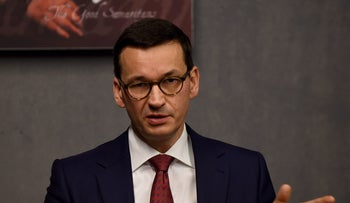 Polish Prime Minister Mateusz Morawiecki talks to the press during his visit on January 2, 2018 to the Ulma Family Museum in Poland that is documenting the fate of the Polish Ulma family, killed by Nazi Germans for rescuing Jews during the Holocaust.