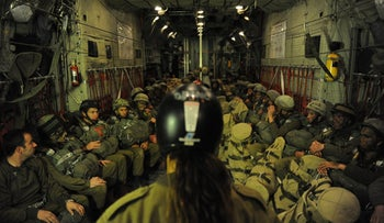 Israeli paratroopers inside an airplane during the last major drill held in 2012.