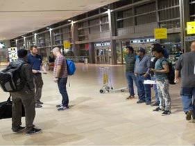 Asylum seekers at the Ben-Gurion Airport in 2015, depicted leaving the country after facing the option of moving out of Israel or getting incarcerated.
