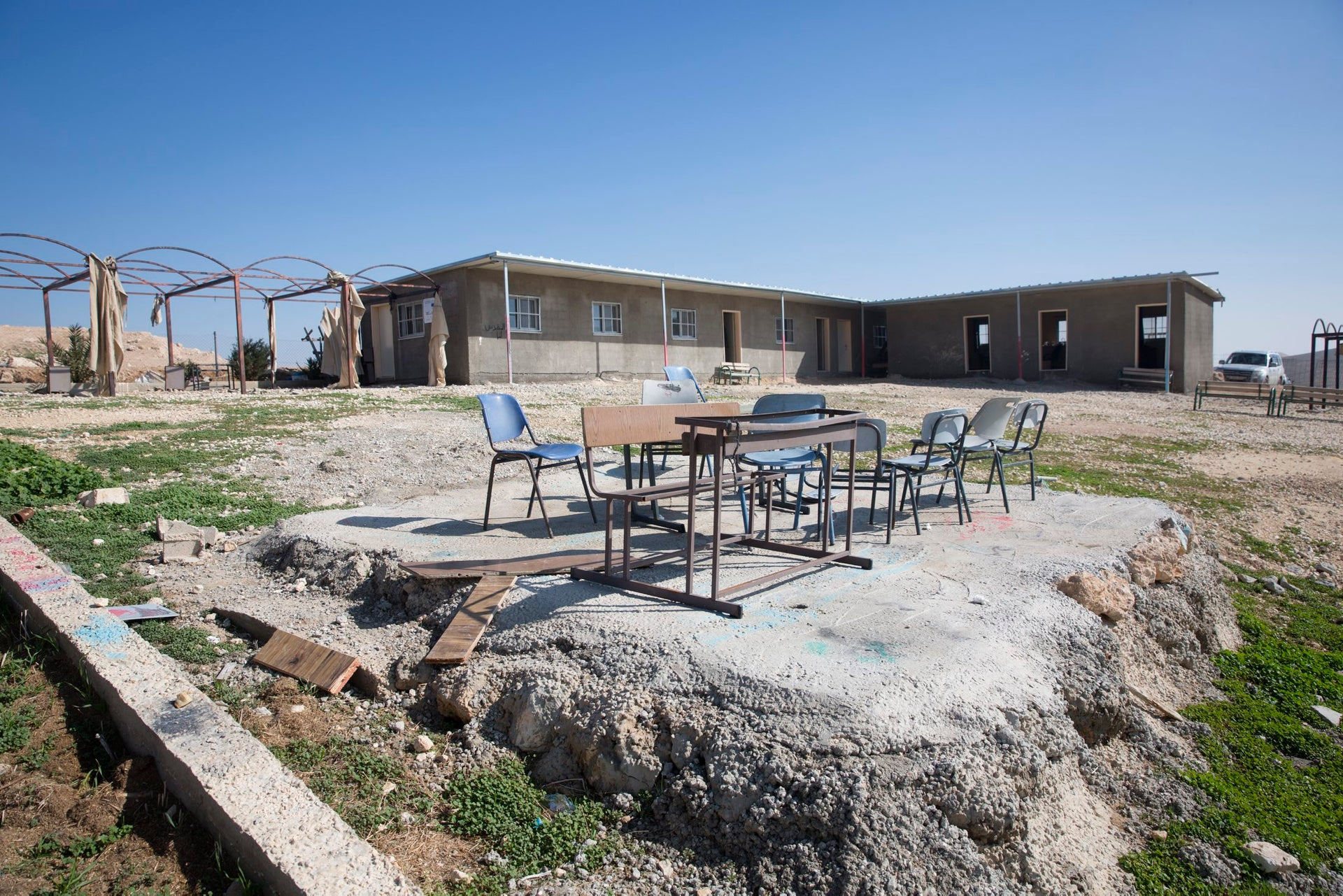 A desk and chairs outside the only school in the village of Al Muntar in the West Bank.