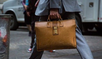 Illustration: A man carries a briefcase.