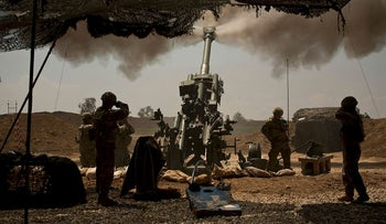 In this April 17, 2017 file photo, U.S. soldiers from the 82nd Airborne Division fire artillery in support of Iraqi forces fighting Islamic State militants from their base east of Mosul