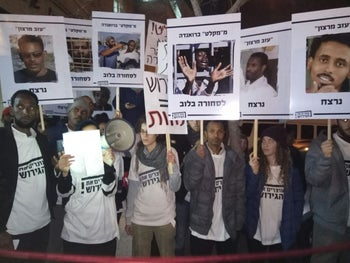 """Members of """"Stop the Deportation"""" protesting the government's plan to deport nearly 40,000 African asylum seekers from Israel."""