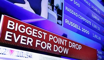 A television screen on the floor of the New York Stock Exchange headlines the stock index news at the close of trading, Monday, Feb. 5, 2018.
